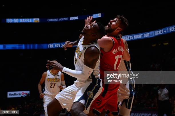 Paul Millsap of the Denver Nuggets and Jonas Valanciunas of the Toronto Raptors await the ball during the game on November 1 2017 at the Pepsi Center...