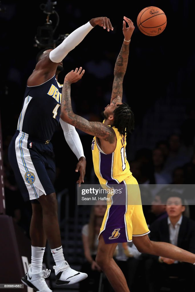 Paul Millsap #4 of the Denver Nuggets blocks a shot by Brandon Ingram #14 of the Los Angeles Lakers during the first half of a preseason game at Staples Center on October 2, 2017 in Los Angeles, California.