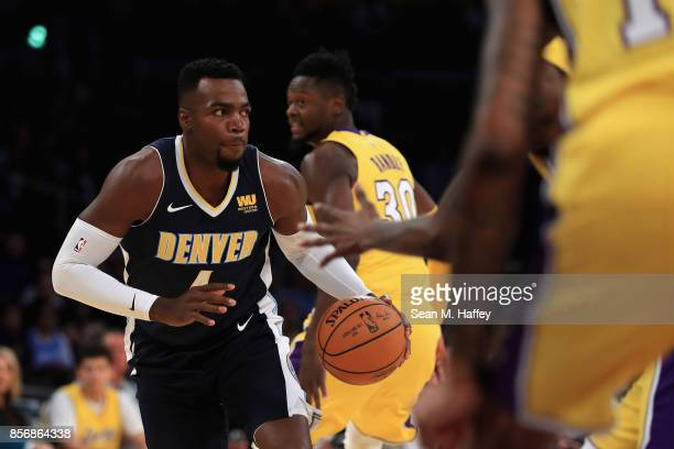 Paul Millsap of the Denver Nuggets dribbles upcourt during the first half of a preseason game against the Los Angeles Lakers at Staples Center on...