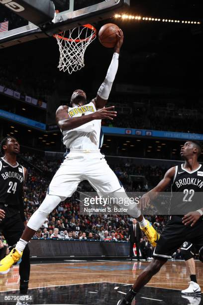 Paul Millsap of the Denver Nuggets drives to the basket against the Brooklyn Nets on October 29 2017 at Barclays Center in Brooklyn New York NOTE TO...