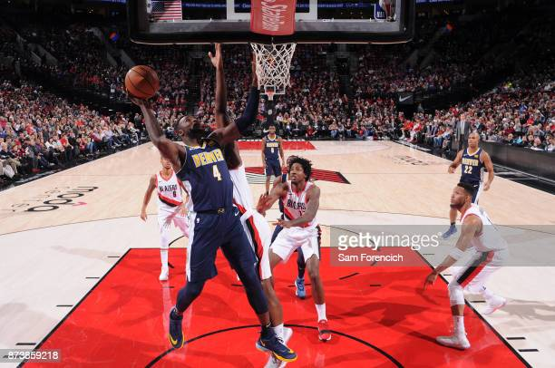Paul Millsap of the Denver Nuggets drives to the basket against the Portland Trail Blazers on November 13 2017 at the Moda Center in Portland Oregon...