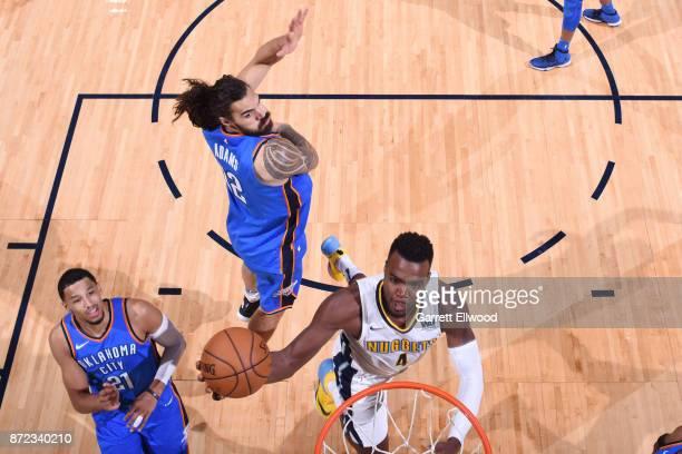 Paul Millsap of the Denver Nuggets dunks against the Oklahoma City Thunder on November 9 2017 at the Pepsi Center in Denver Colorado NOTE TO USER...