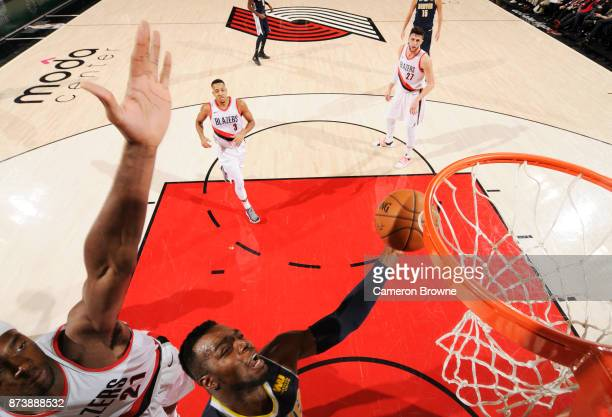 Paul Millsap of the Denver Nuggets dunks against the Portland Trail Blazers on November 13 2017 at the Moda Center in Portland Oregon NOTE TO USER...