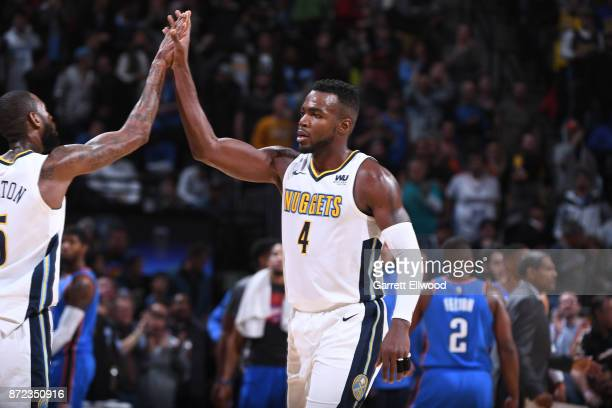Paul Millsap of the Denver Nuggets give high fives after defeating the Oklahoma City Thunder on November 9 2017 at the Pepsi Center in Denver...