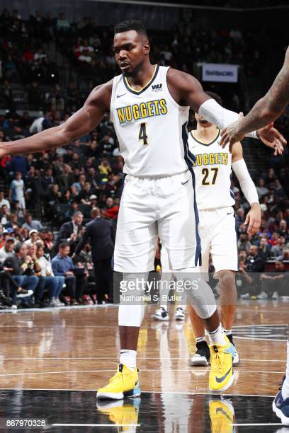 Paul Millsap of the Denver Nuggets gives high five to teammates during the game against the Brooklyn Nets on October 29 2017 at Barclays Center in...