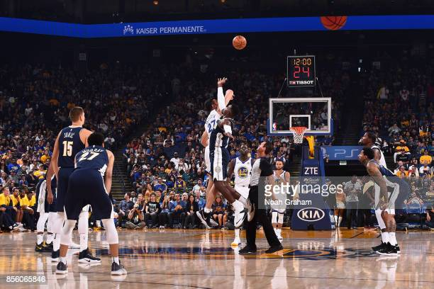 Paul Millsap of the Denver Nuggets goes for the tip off against Zaza Pachulia of the Golden State Warriors during a preseason game on September 30...
