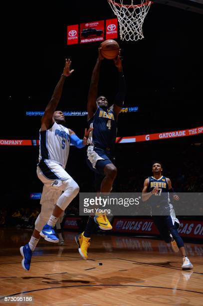 Paul Millsap of the Denver Nuggets goes to the basket against Marreese Speights of the Orlando Magic on November 11 2017 at the Pepsi Center in...