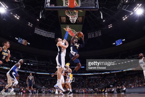 Paul Millsap of the Denver Nuggets goes to the basket against the Orlando Magic on November 11 2017 at the Pepsi Center in Denver Colorado NOTE TO...