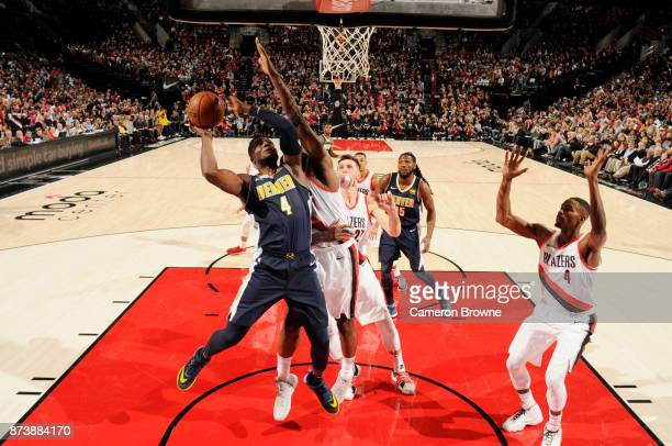 Paul Millsap of the Denver Nuggets goes to the basket against the Portland Trail Blazers on November 13 2017 at the Moda Center in Portland Oregon...