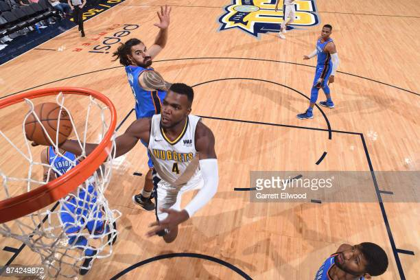 Paul Millsap of the Denver Nuggets goes to the basket against the Oklahoma City Thunder on November 9 2017 at the Pepsi Center in Denver Colorado...