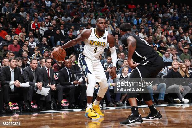 Paul Millsap of the Denver Nuggets handles the ball against the Brooklyn Nets on October 29 2017 at Barclays Center in Brooklyn New York NOTE TO USER...