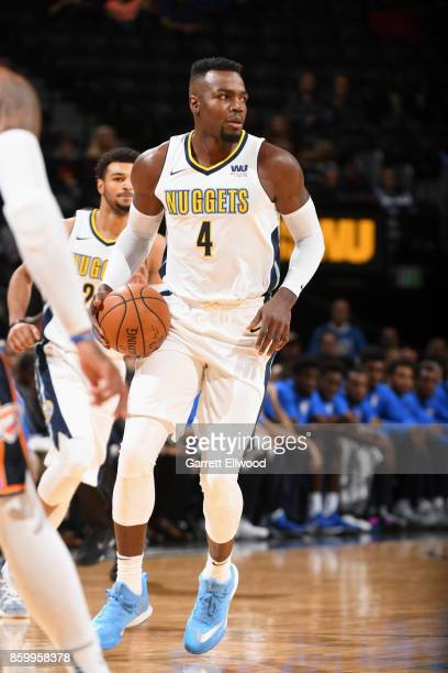 Paul Millsap of the Denver Nuggets handles the ball during the game against the Oklahoma City Thunder on October 10 2017 at the Pepsi Center in...