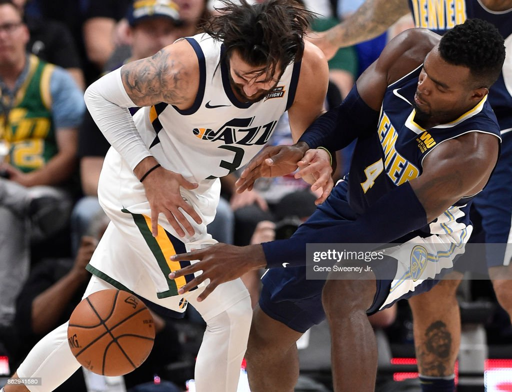 Paul Millsap #4 of the Denver Nuggets knocks the ball away from Ricky Rubio #3 of the Utah Jazz during the second half of the 106-96 win by the Jazz at Vivint Smart Home Arena on October 18, 2017 in Salt Lake City, Utah.
