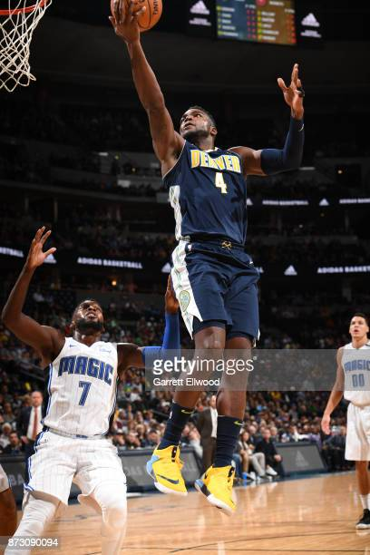 Paul Millsap of the Denver Nuggets shoots a lay up against the Orlando Magic on November 11 2017 at the Pepsi Center in Denver Colorado NOTE TO USER...