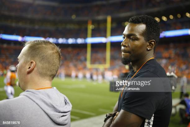 Paul Millsap of the Denver Nuggets watches the Denver Broncos warm up before the game against the Los Angeles Chargers at Sports Authority Field at...