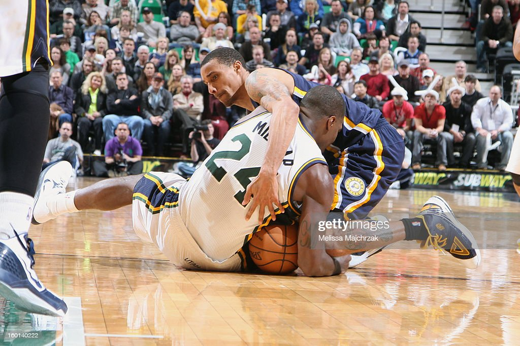 Paul Millsap #24 of the Utah Jazz and George Hill #3 of the Indiana Pacers wrestle for a loose ball at Energy Solutions Arena on January 26, 2013 in Salt Lake City, Utah.