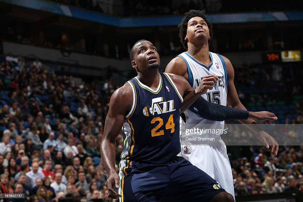 Paul Millsap #24 of the Utah Jazz battles for positioning against Mickael Gelabale #15 of the Minnesota Timberwolves on February 13, 2013 at Target Center in Minneapolis, Minnesota.