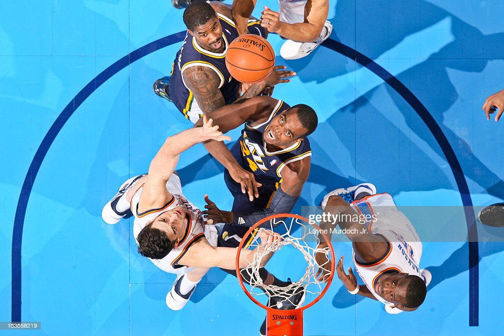 <a gi-track='captionPersonalityLinkClicked' href=/galleries/search?phrase=Paul+Millsap&family=editorial&specificpeople=880017 ng-click='$event.stopPropagation()'>Paul Millsap</a> #24 of the Utah Jazz battles for rebound position against <a gi-track='captionPersonalityLinkClicked' href=/galleries/search?phrase=Nick+Collison&family=editorial&specificpeople=202843 ng-click='$event.stopPropagation()'>Nick Collison</a> #4 of the Oklahoma City Thunder on March 13, 2013 at the Chesapeake Energy Arena in Oklahoma City, Oklahoma.