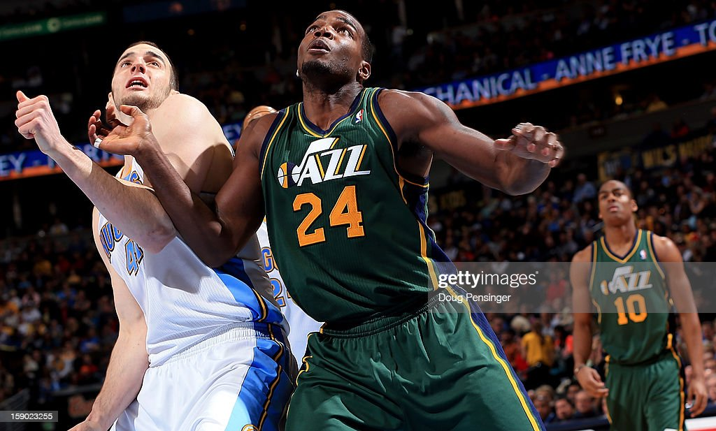 Paul Millsap #24 of the Utah Jazz battles for rebounding position against Kosta Koufos #41 of the Denver Nuggets at the Pepsi Center on January 5, 2013 in Denver, Colorado. The Nuggets defeated the Jazz 110-91.