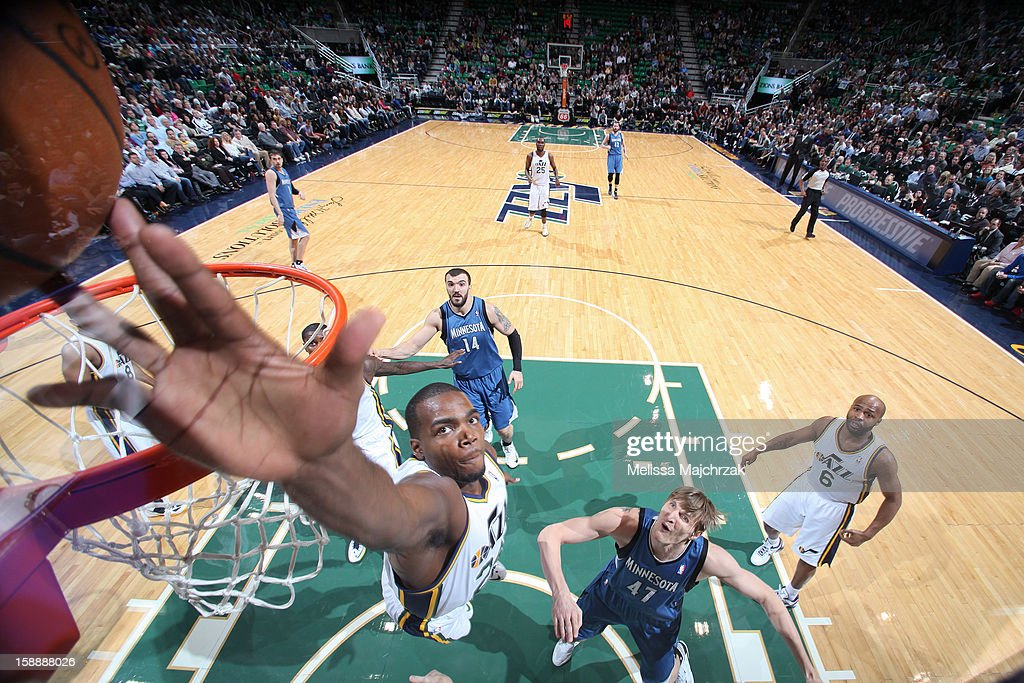 Paul Millsap #24 of the Utah Jazz blocks a shot by Luke Ridnour #13 of the Minnesota Timberwolves at Energy Solutions Arena on January 2, 2013 in Salt Lake City, Utah.