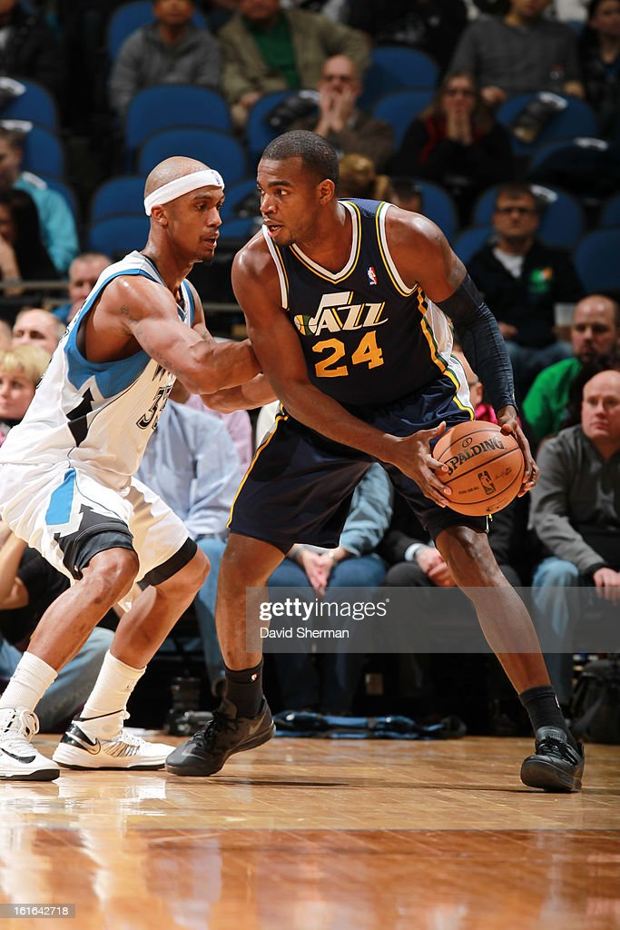 Paul Millsap #24 of the Utah Jazz controls the ball against Dante Cunningham #33 of the Minnesota Timberwolves on February 13, 2013 at Target Center in Minneapolis, Minnesota.