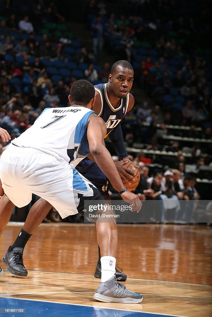 Paul Millsap #24 of the Utah Jazz controls the ball against Derrick Williams #7 of the Minnesota Timberwolves on February 13, 2013 at Target Center in Minneapolis, Minnesota.