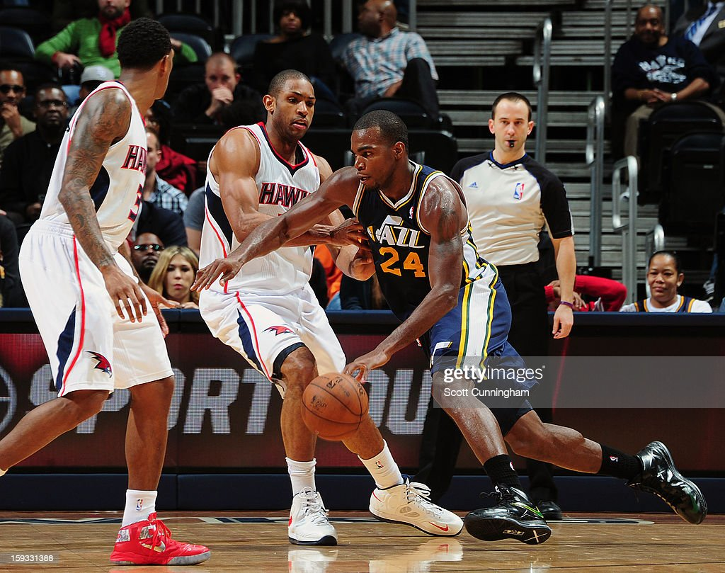 Paul Millsap #24 of the Utah Jazz dribbles the ball in traffic against the Atlanta Hawks on January 11, 2013 at Philips Arena in Atlanta, Georgia.