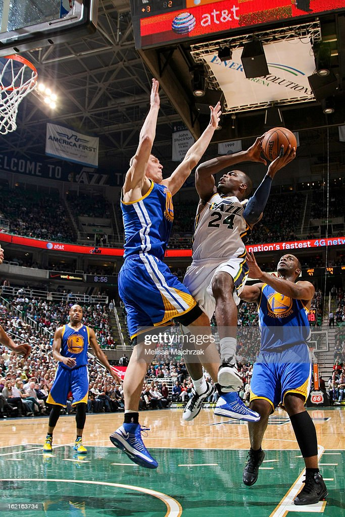 Paul Millsap #24 of the Utah Jazz drives to the basket against Andris Biedrins #15 and Carl Landry #7 of the Golden State Warriors at Energy Solutions Arena on February 19, 2013 in Salt Lake City, Utah.