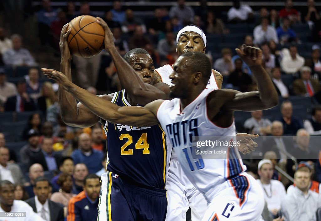 Paul Millsap #24 of the Utah Jazz drives to the basket against Kemba Walker #15 of the Charlotte Bobcats during their game at Time Warner Cable Arena on January 9, 2013 in Charlotte, North Carolina.