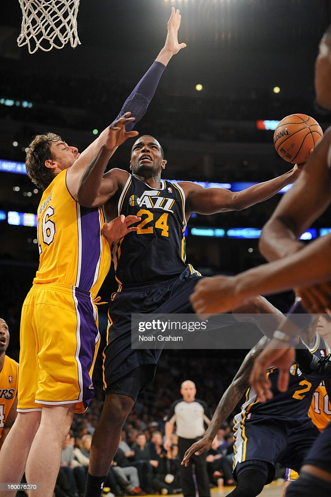 Paul Millsap #24 of the Utah Jazz drives to the basket against Pau Gasol #16 of the Los Angeles Lakers at Staples Center on January 25, 2013 in Los Angeles, California.