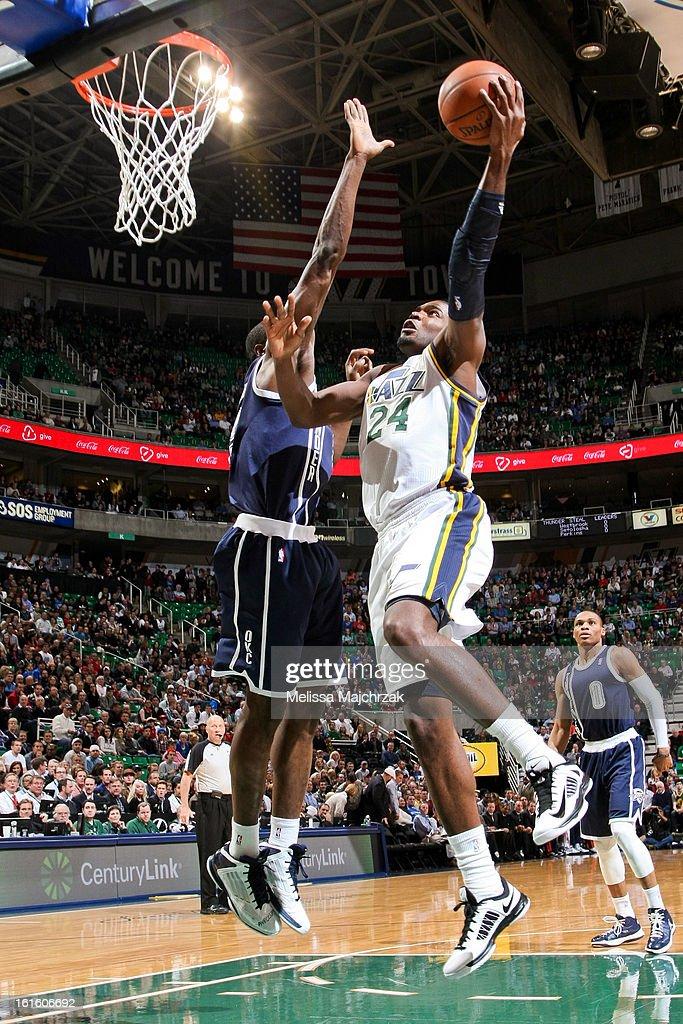 Paul Millsap #24 of the Utah Jazz drives to the basket against the Oklahoma City Thunder at Energy Solutions Arena on February 12, 2013 in Salt Lake City, Utah.