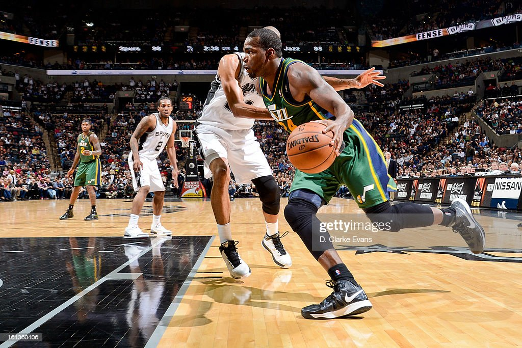 Paul Millsap #24 of the Utah Jazz drives to the basket against the San Antonio Spurs on March 22, 2013 at the AT&T Center in San Antonio, Texas.