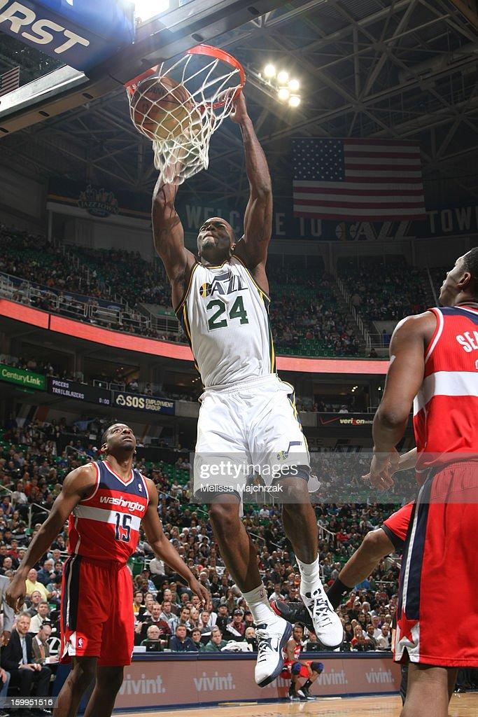 Paul Millsap #24 of the Utah Jazz dunks against Jordan Crawford #15 and Kevin Seraphin #13 of the Washington Wizards at Energy Solutions Arena on January 23, 2013 in Salt Lake City, Utah.