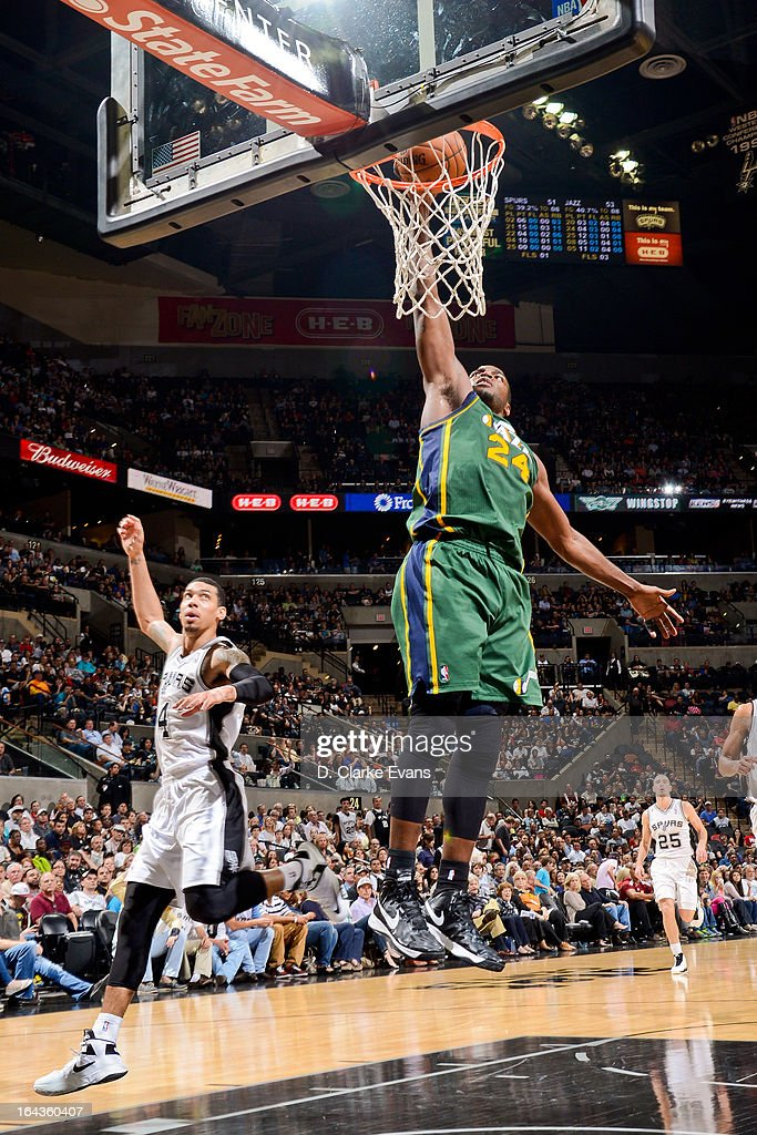Paul Millsap #24 of the Utah Jazz dunks against the San Antonio Spurs on March 22, 2013 at the AT&T Center in San Antonio, Texas.