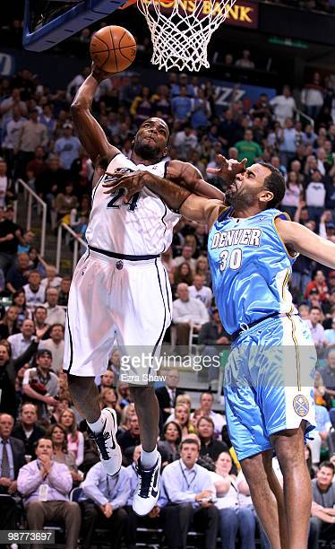 Paul Millsap of the Utah Jazz dunks over Malik Allen of the Denver Nuggets during Game Six of the Western Conference Quarterfinals of the 2010 NBA...