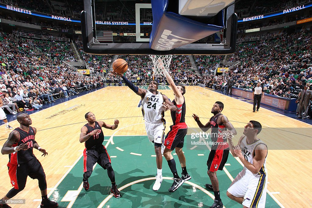 <a gi-track='captionPersonalityLinkClicked' href=/galleries/search?phrase=Paul+Millsap&family=editorial&specificpeople=880017 ng-click='$event.stopPropagation()'>Paul Millsap</a> #24 of the Utah Jazz goes to the basket against <a gi-track='captionPersonalityLinkClicked' href=/galleries/search?phrase=Andrea+Bargnani&family=editorial&specificpeople=533014 ng-click='$event.stopPropagation()'>Andrea Bargnani</a> #7 of the Toronto Raptors at Energy Solutions Arena on December 07, 2012 in Salt Lake City, Utah.