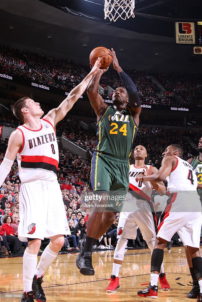 Paul Millsap #24 of the Utah Jazz goes to the basket against Luke Babbitt #8 of the Portland Trail Blazers during the game between the Utah Jazz and the Portland Trail Blazers on February 2, 2013 at the Rose Garden Arena in Portland, Oregon.