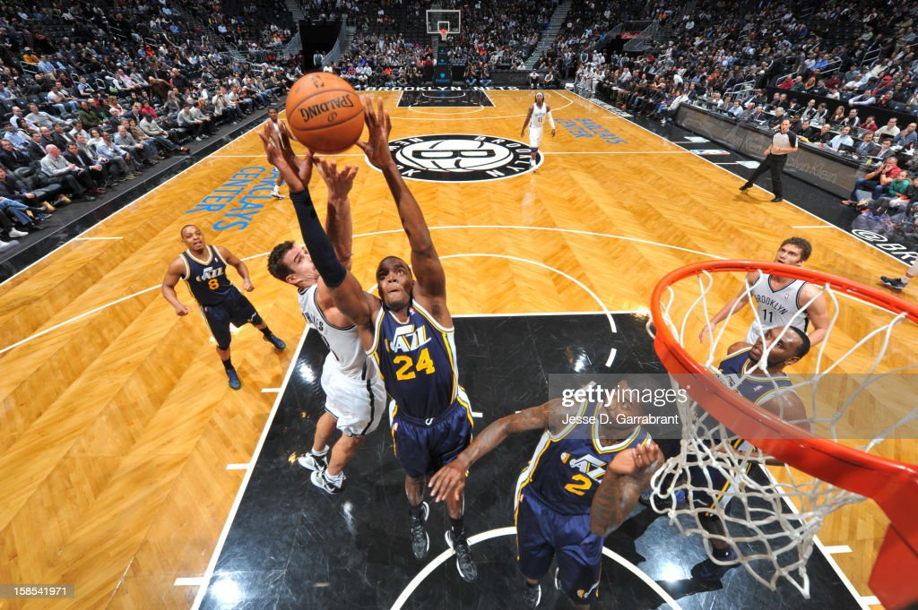 Paul Millsap #24 of the Utah Jazz goes up for a rebound against Kris Humphries #43 of the Brooklyn Nets during the game at the Barclays Center on December 18, 2012 in Brooklyn, New York.