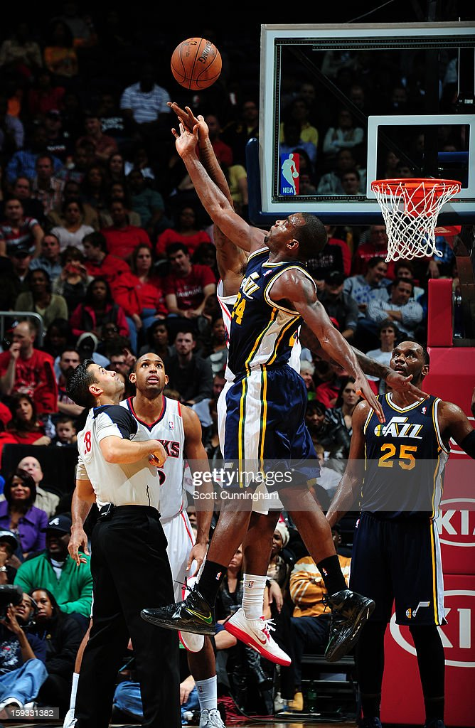 <a gi-track='captionPersonalityLinkClicked' href=/galleries/search?phrase=Paul+Millsap&family=editorial&specificpeople=880017 ng-click='$event.stopPropagation()'>Paul Millsap</a> #24 of the Utah Jazz goes up for the loose ball against the Atlanta Hawks on January 11, 2013 at Philips Arena in Atlanta, Georgia.