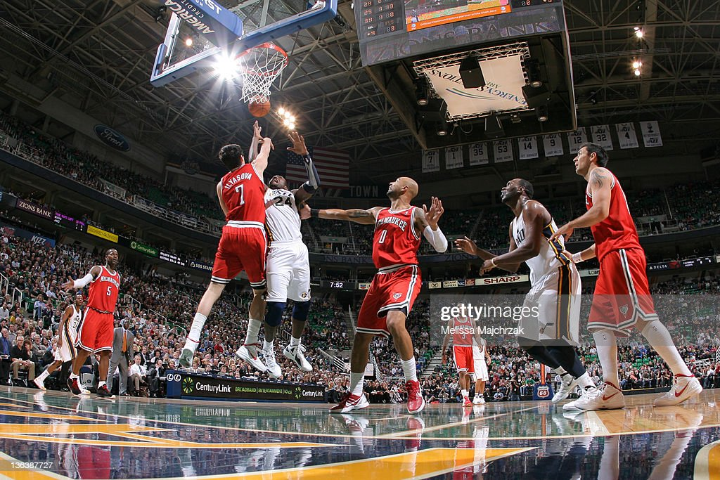 Paul Millsap of the Utah Jazz goes up for the shot against Ersan Ilyasova of the Milwaukee Bucks at Energy Solutions Arena on January 03 2012 in Salt...