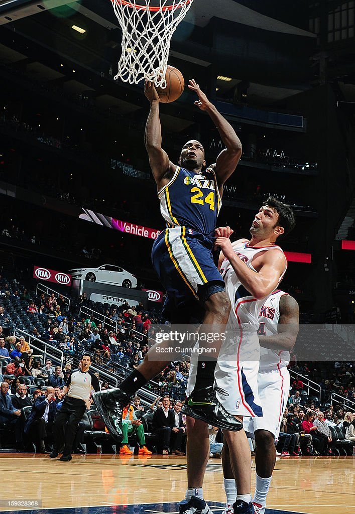 Paul Millsap #24 of the Utah Jazz goes up strong to the basket against the Atlanta Hawks on January 11, 2013 at Philips Arena in Atlanta, Georgia.