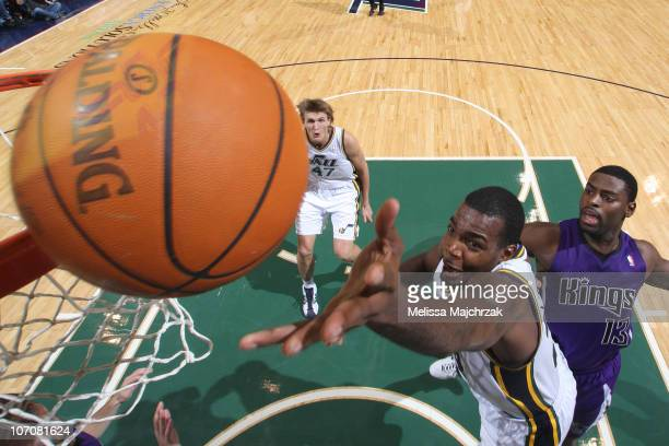 Paul Millsap of the Utah Jazz lays it up over Tyreke Evans of the Sacramento Kings at EnergySolutions Arena on November 22 2010 in Salt Lake City...