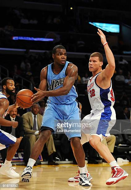 Paul Millsap of the Utah Jazz looks to pass against Blake Griffin of the Los Angeles Clippers during a preseason game at Staples Center on October 17...