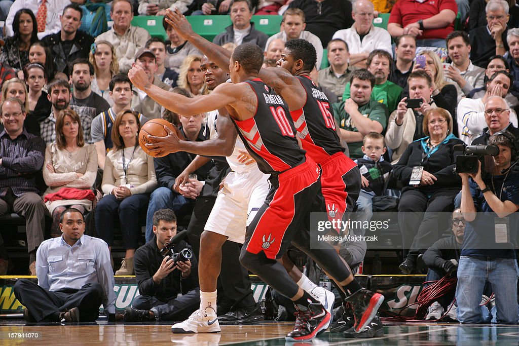 <a gi-track='captionPersonalityLinkClicked' href=/galleries/search?phrase=Paul+Millsap&family=editorial&specificpeople=880017 ng-click='$event.stopPropagation()'>Paul Millsap</a> #24 of the Utah Jazz looks to pass around DeMar DeRozan #10 and <a gi-track='captionPersonalityLinkClicked' href=/galleries/search?phrase=Amir+Johnson&family=editorial&specificpeople=556786 ng-click='$event.stopPropagation()'>Amir Johnson</a> #15 of the Toronto Raptors at Energy Solutions Arena on December 07, 2012 in Salt Lake City, Utah.