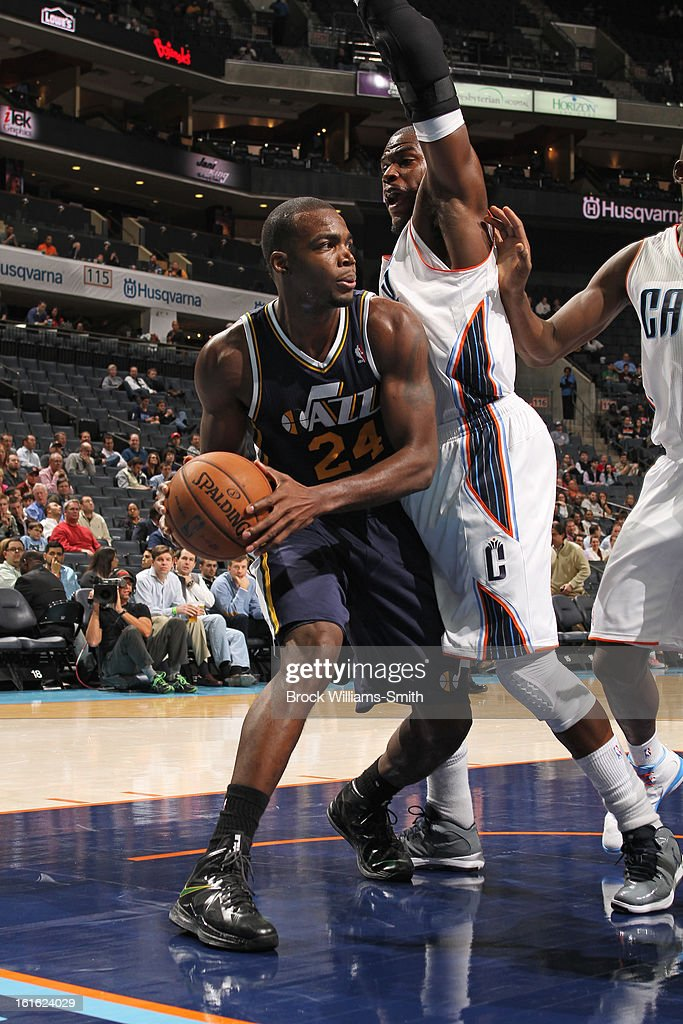 Paul Millsap #24 of the Utah Jazz looks to pass the ball against the Charlotte Bobcats at the Time Warner Cable Arena on January 9, 2013 in Charlotte, North Carolina.
