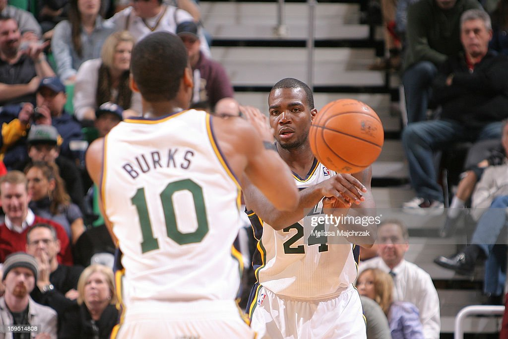 Paul Millsap #24 of the Utah Jazz passes to teammate Derrick Favors #15 during play against the Miami Heat at Energy Solutions Arena on January 14, 2013 in Salt Lake City, Utah.