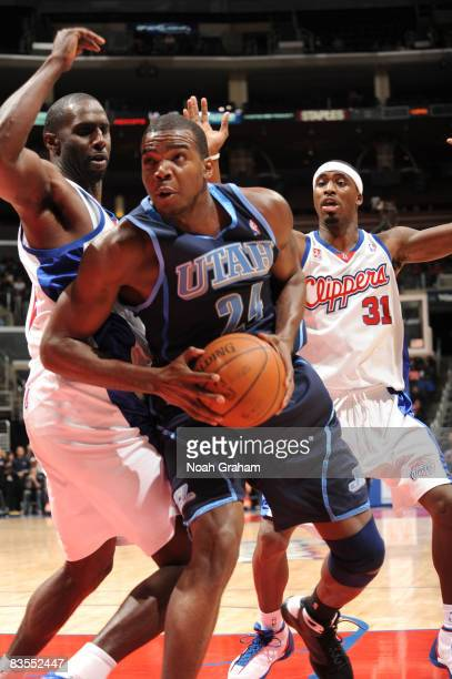 Paul Millsap of the Utah Jazz prepares to go up for a shot against Tim Thomas of the Los Angeles Clippers at Staples Center on November 3 2008 in Los...