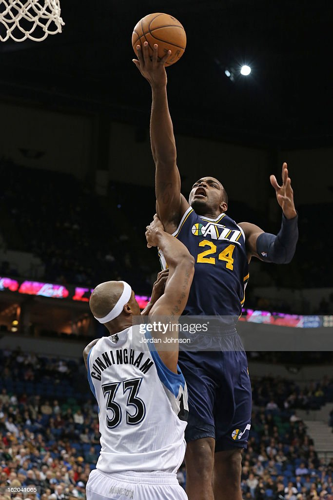 <a gi-track='captionPersonalityLinkClicked' href=/galleries/search?phrase=Paul+Millsap&family=editorial&specificpeople=880017 ng-click='$event.stopPropagation()'>Paul Millsap</a> #24 of the Utah Jazz puts up a shot against the Minnesota Timberwolves on February 13, 2013 at Target Center in Minneapolis, Minnesota.