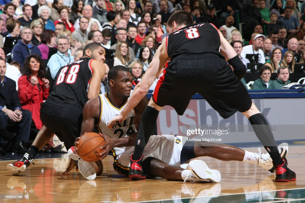 <a gi-track='captionPersonalityLinkClicked' href=/galleries/search?phrase=Paul+Millsap&family=editorial&specificpeople=880017 ng-click='$event.stopPropagation()'>Paul Millsap</a> #24 of the Utah Jazz recovers a lose ball and looks to pass against <a gi-track='captionPersonalityLinkClicked' href=/galleries/search?phrase=Nicolas+Batum&family=editorial&specificpeople=3746275 ng-click='$event.stopPropagation()'>Nicolas Batum</a> #88 and <a gi-track='captionPersonalityLinkClicked' href=/galleries/search?phrase=Luke+Babbitt&family=editorial&specificpeople=5122155 ng-click='$event.stopPropagation()'>Luke Babbitt</a> #8 of the Portland Trail Blazers at Energy Solutions Arena on February 01, 2013 in Salt Lake City, Utah.