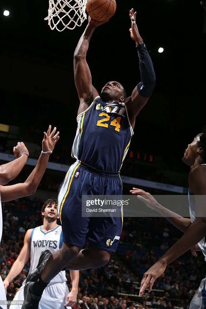 Paul Millsap #24 of the Utah Jazz rises for a dunk against the Minnesota Timberwolves on February 13, 2013 at Target Center in Minneapolis, Minnesota.